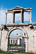 The Acropolis can be seen through the Arch of Hadrian in Athens, Greece