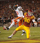 Nov 18, 2011; Ames, IA, USA; Oklahoma State Cowboys safety Markelle Martin (10) breaks up a pass intended for  Iowa State Cyclones tight end Kurt Hammerschmidt (86) during a game at Jack Trice Stadium.  Mandatory Credit: Beth Hall-US PRESSWIRE Editorial sports photography of the Iowa State Cyclones vs. Oklahoma State Cowboys in 2011 in Aimes, Iowa.