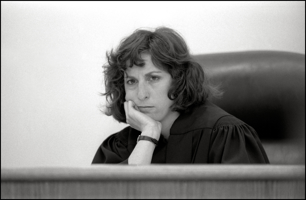 """In April of 1991, Judge Laura E. Drager presided over the trial of Gregg Bordowitz, Velma Campbell, Cynthia Cochran, Richard Elovich, Phillip Flores, Debra Levine, Kathryn Otter, Jon Stuen Parker, Monica Pearl and Dan Keith Williams who were arrested on March 6, 1990 after they set up a table in Lower Manhattan and tried to give clean hypodermic needles to drug addicts to prevent them from getting AIDS. Most of the eight defendants were members of ACT UP (AIDS Coalition to Unleash Power).<br /> <br /> In her ruling, Judge Drager invoked the so-called necessity justification in the state penal law. It states that """"conduct which would otherwise constitute an offense is justifiable and not criminal when such conduct is necessary as an emergency measure to avoid an imminent public or private injury."""""""