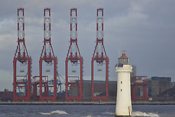 November 5, 2016 - Liverpool, England, United Kingdom - Cranes, along with New Brighton Lighthouse in the foreground, stand at the site of the new Liverpool 2 deep-sea container port on November 5, 2016 in Liverpool, England. (Credit Image: © Jonathan Nicholson/NurPhoto via ZUMA Press)