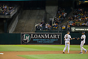 San Francisco Giants second baseman Joe Panik (12) hands his helmet to staff after being tagged out during a base stealing attempt against the Oakland Athletics at Oakland Coliseum in Oakland, California, on July 31, 2017. (Stan Olszewski/Special to S.F. Examiner)