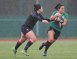 Wales women's Rebecca De Filippo tackles Ireland women's Sene Naoupu<br /> <br /> Photographer Mike Jones/Replay Images<br /> <br /> International Friendly - Wales women v Ireland women - Sunday 21st January 2018 - CCB Centre for Sporting Excellence - Ystrad Mynach<br /> <br /> World Copyright © Replay Images . All rights reserved. info@replayimages.co.uk - http://replayimages.co.uk