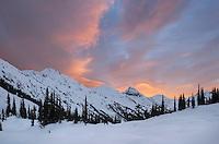 Colorful winter sunrise above Marriott Basin, Coast Mountains British Columbia