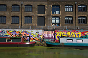 Street art by various artists along the Lea Navigational canal in Hackney Wick, East London, United Kingdom. Street art in the East End of London is an ever changing visual enigma, as the artworks constantly change, as councils clean some walls or new works go up in place of others. While some consider this vandalism or graffiti, these artworks are very popular among local people and visitors alike, as a sense of poignancy remains in the work, many of which have subtle messages. (photo by Mike Kemp/In Pictures via Getty Images)