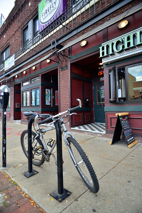 Bicycle parked in front of Highland Tavern.