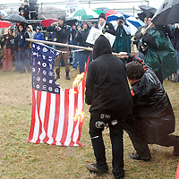 Protestors burn a flag at Saturday's The World Can't Wait Protest in Washington, D.C.
