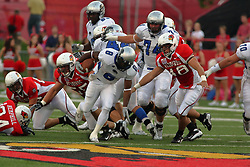 20 September 2008: Travorus Bess stumbles getting past Eric Brunner but still has Pat Cucci closing in during Illinois State Redbirds home opener lose to the #20 ranked Eastern Illinois Panthers at Hancock Stadium on the campus of Illinois State University in Normal Illinois. Final score was 25-21.