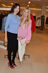 Left to right, JASMINE GUINNESS and ALICE NAYLOR-LEYLAND at the launch of the 'Jasmine for Jaeger' fashion collection by Jasmine Guinness for fashion label Jaeger held at Fenwick's, Bond Street, London on 9th September 2015.
