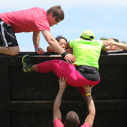Large oversized competitors in action at the wall climb obstacle during the Reebok Spartan Race. Mohegan Sun, Uncasville, Connecticut, USA. 28th June 2014. Photo Tim Clayton