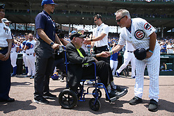 July 4, 2018 - Chicago, IL, USA - WWII veteran Sidney Walton, 99, is greeted by Chicago Cubs manager Joe Maddon (70)  before a game between the Chicago Cubs and Detroit Tigers at Wrigley Field Wednesday, July 4, 2018, in Chicago. (Credit Image: © John J. Kim/TNS via ZUMA Wire)