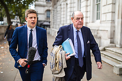 """© Licensed to London News Pictures. 03/09/2019. London, UK. Sir Nicholas Soames (R), believed to be one of the Tory """"rebels"""" willing to vote against the government, arrives at the Cabinet Office. MPs return from recess today and may vote on legislation to block a no deal exit from the European Union. Photo credit: Rob Pinney/LNP"""