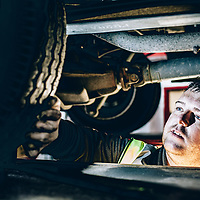 Reportage style  workplace photography of car maintenance
