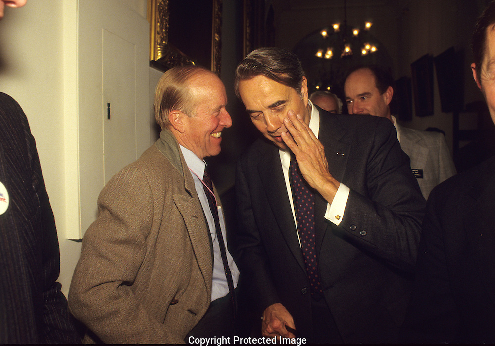 Rowland Evans and Bob Dole together on the Bob Dole campaign in January 1988..Photograph by Dennis Brack