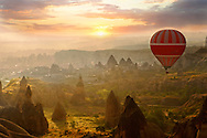 Hot air baloon over Goreme at sunrise Cappadocia Turkey .<br /> <br /> If you prefer to buy from our ALAMY PHOTO LIBRARY  Collection visit : https://www.alamy.com/portfolio/paul-williams-funkystock/cappadocia-balloons.html<br /> <br /> Visit our TURKEY PHOTO COLLECTIONS for more photos to download or buy as wall art prints https://funkystock.photoshelter.com/gallery-collection/3f-Pictures-of-Turkey-Turkey-Photos-Images-Fotos/C0000U.hJWkZxAbg
