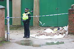 © Licensed to London News Pictures . Blackpool , UK . 04/02/2013 . A police officer stands guard in an alley behind the Grafton House Hotel , Kirby Road , Blackpool today (4th February 2013) where Sasha Marsden was found murdered , as David Minto is due before Magistrates , charged with the murder of the 16 year old this morning (4th February 2013) . Photo credit : LNP