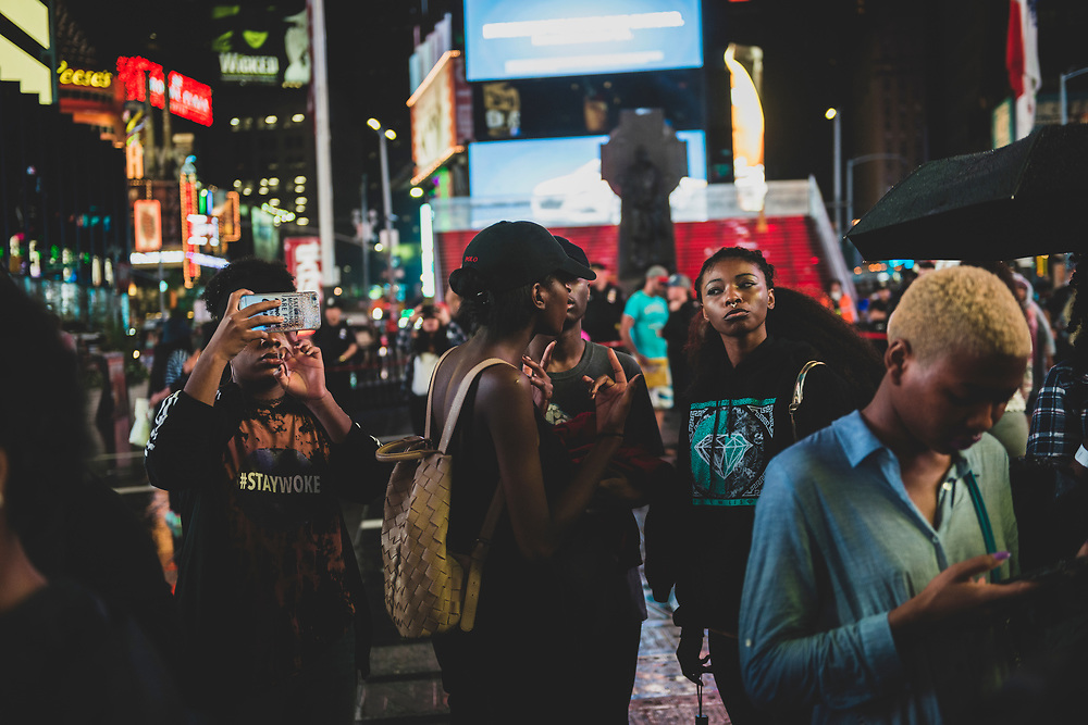 New York City, USA - July 9, 2016: People talk together at a Black Lives Matter protest in Times Square in New York City.