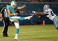 August 23rd, 2014, Miami Dolphins punter Brandon Fields (2) punt is block by Dallas Cowboys outside linebacker Bruce Carter (54) during a game between the Miami Dolphins and the Dallas Cowboys at Sun Life Stadium in Miami Garden, FL NFL American Football Herren USA AUG 23 Preseason - Cowboys at Dolphins PUBLICATIONxINxGERxSUIxAUTxHUNxRUSxSWExNORxONLY Icon140823008<br /> <br /> August 23rd 2014 Miami Dolphins Punter Brandon Fields 2 Punt is Block by Dallas Cowboys Outside Linebacker Bruce Carter 54 during A Game between The Miami Dolphins and The Dallas Cowboys AT Sun Life Stage in Miami Garden Fl NFL American Football men USA Aug 23 Preseason Cowboys AT Dolphins PUBLICATIONxINxGERxSUIxAUTxHUNxRUSxSWExNORxONLY