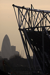 Olympic Stadium. Silhouette of construction on the Olympic Stadium, with the City of London visible in the background. Picture taken on 16 March 2009 by David Poultney.
