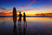 Couple Standing at Low Tide at the San Clemente Pier