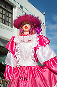 View of a street performer with a puppet in a pink dress on the street in a city, Leon, Nicaragua