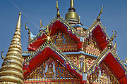 Ornamental architecture of Wat Chayamangkalaram, a Thai temple of The Reclining Buddha shines in bright tropical sun. It is located in Georgetown on the island of Penang, Malaysia.