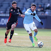 NEW YORK, NEW YORK - March 12:  Ronald Matarrita #22 of New York City FC is challenged by Lamar Neagle #13 of D.C. United during the NYCFC Vs D.C. United regular season MLS game at Yankee Stadium on March 12, 2017 in New York City. (Photo by Tim Clayton/Corbis via Getty Images)