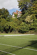 View from the tennis court to the house at The Old Rectory, Chumleigh, Devon CREDIT: Vanessa Berberian for The Wall Street Journal<br /> LUXRENT-Nanassy/Chulmleigh