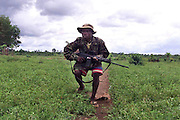 SLA SOLDIERS & ELEMENTS OF THE CDF DEFEND THE BERI CROSSING IN A HEAVY FIREFIGHT WITH THE RUF AFTER TAKING THE AREA THIS MORNING FROM REBEL HANDS...<br /> <br /> 21 May 2000 Sierra Leone