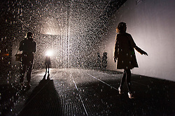 © licensed to London News Pictures. London, UK 03/10/2012. People walking in Random International's Rain Room installation, which featuring 100 square metres of pelting water falling from around 4 metre high at The Curve Gallery in Barbican Centre, London. When visitors walk through the rain stops around them. Photo credit: Tolga Akmen/LNP