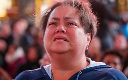 © Licensed to London News Pictures. 09/11/2016. New York City, USA. An emotional woman breaks down in tears as she reacts to news that Donald Trump looks likely to be elected as the next president of the United States, while gathering in Times Square, New York City, on Wednesday, 9 November. Photo credit: Tolga Akmen/LNP