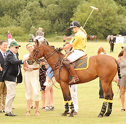 Asprey World Class Cup polo held at Hurtwood Park Polo Club, Ewhurst, Surrey on 17th July 2010.<br /> Picture shows:- PRINCE ALBERT OF MONACO, Charlene Wittstock talk to polo play AMY GUY