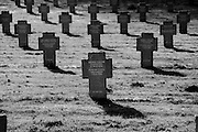 Somme WW1 Battlefield, July 1st-November 1916, France. German Military Cemetery at Rancourt ( Rancourt Soldatenfriedhof ). February 2014<br /> <br /> There are only a few graves here from the early months of the war. Two thirds of the dead lying here are from the Battle of the Somme between July and November 1916. Most of the remainder are from the summer of 1918.<br /> <br /> In 1929 repairs were carried out following negotiations with the French Government and the mass graves were given a proper wall and planted with roses. Trees were planted and the cemetery was inaugurated on 17 September 1933.<br /> <br /> The problem of how to mark the names of the fallen had to wait until the end of the Second World War for a solution and eventually in 1972 the wooden crosses were replaced with crosses made from Belgian granite.<br /> <br /> There are two mass graves containing the remains of 7,492 soldiers of whom only 2,316 could be identified.