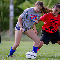 Grants Pirates DeAvantae Aldaaz, right, and Alexa Vigil fight for control of the ball as they run drills Wednesday at Grants High School.