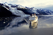 Alaska. Prince William Sound. A cruise ship in College Fjord, sailing past Bryn Mawr, Harvard, and Smith Glaciers with the Chugach Mts beyond.