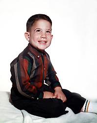 little boy in studio setting, 1960's
