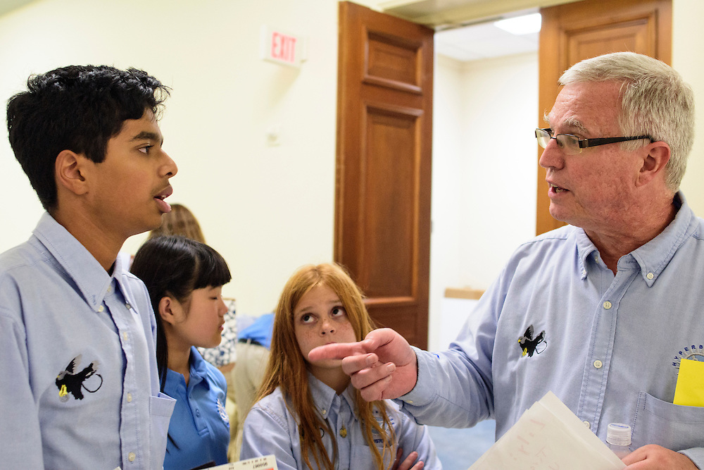 Washington, D.C. - October 07, 2016: Hyperbolics coach Bob Brown gives constructive feedback to Rohit Rajagopalan after their final presentation of the day.<br /> <br /> The Hyperbolics are a First Lego League team based out of Sterling School in Greenville SC, who made a trip to DC ask government officials to ban lead wheel weights Friday October 7, 2016.<br /> <br /> <br /> CREDIT: Matt Roth for Earthjustice