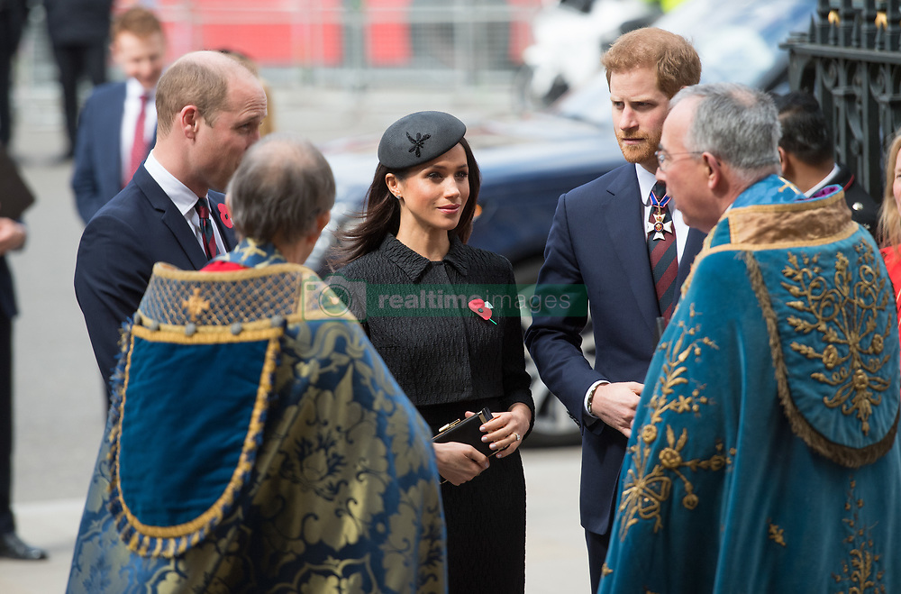 Meghan Markle, wearing a black Emilia Wickstead jacket and skirt and a Philip Treacy hat, Prince Harry and Prince William, Duke of Cambridge attend the Anzak Day service at Westminster Abbey in London on April 25, 2018.