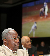 ATLANTA, GA - MAY 14:  Hall of Fame baseball player Hank Aaron watches a tribute video showing him hitting his 715th career home run at the Major League Baseball Beacon Awards Banquet at the Omni Hotel on May 14, 2011 in Atlanta, Georgia.  (Photo by Mike Zarrilli/Getty Images)