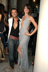 JULIEN MACDONALD and MARGO STILLEY at the Tatler Summer Party in association with Moschino at Home House, 20 Portman Square, London W1 on 29th June 2005.<br />