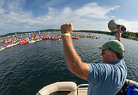 NH Lakes Chief Tom O'Brien gives the crowd a cheer after successfully joining together their kayaks and canoes in an attempt to break the Guinness World Record during Lake Fest held off Weirs Beach Saturday morning.  (Karen Bobotas/for the Laconia Daily Sun)