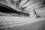 Grain elevator and clouds, Orkney, Saskatchewan, Canada