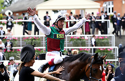 Jockey Frankie Dettori celebrates winning the St James's Palace Stakes on Without Parole during day one of Royal Ascot at Ascot Racecourse.