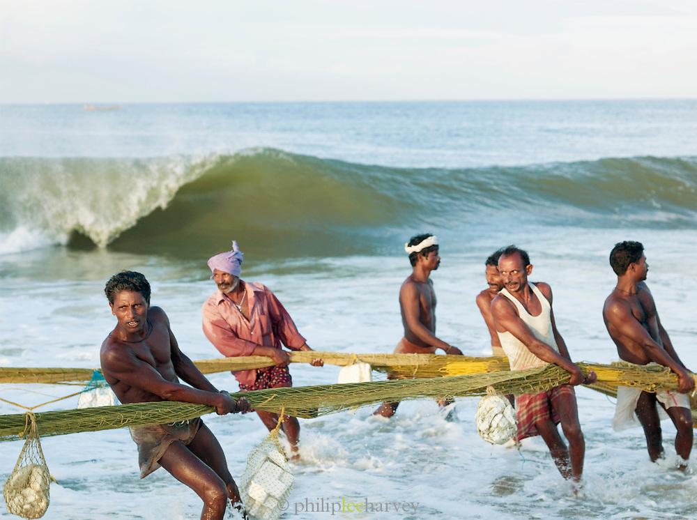 Fishermen bring in thier catch before the monsoon rains begin, Odayam Beach, Kerala, India