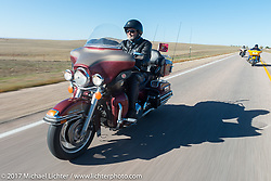 Marine Veteran Phil Bechtold with the Sioux Falls HOG chapter on his 2009 FLHTCUI for theUSS South Dakota submarine flag relay across South Dakota on the first day from Sturgis to Aberdeen. SD. USA. Saturday October 7, 2017. Photography ©2017 Michael Lichter.