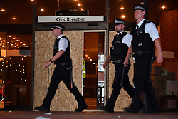 © Licensed to London News Pictures. 16/06/2017. London, UK. The entrance to Kensington town hall boarded up following A demonstration and march by residents and campaigners  in west London following a fire at the Grenfell tower block in west London earlier this week. The blaze engulfed the 27-storey building killing 12 - with 34 people still in hospital, 18 of whom are in critical condition. The fire brigade say that they don't expect to find anyone else alive. Photo credit: Ben Cawthra/LNP