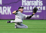 ATLANTA, GA - AUGUST 24:  Left fielder Kyle Parker #16 of the Colorado Rockies makes a diving catch in the second inning during the game against the Atlanta Braves at Turner Field on August 24, 2015 in Atlanta, Georgia.  (Photo by Mike Zarrilli/Getty Images)