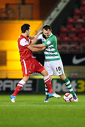 Yeovil Town's Gavin Williams pushes Leyton Orient's Lloyd James aside after he prevents him taking a quick free kick - Photo mandatory by-line: Dougie Allward/JMP - Tel: Mobile: 07966 386802 09/01/2013 - SPORT - FOOTBALL - Matchroom Stadium - London -  Leyton Orient v Yeovil Town - Johnstone's Paint Trophy Southern area semi-final.