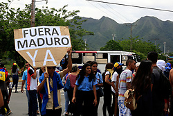 May 24, 2017 - San Diego, Carabobo, Venezuela - High school students decided to close Don Julio Centeno Avenue to protest against President Nicolas Maduro. The avenue is San Diego's main thoroughfare,  Carabobo state. Photo: Juan Carlos Hernandez (Credit Image: © Juan Carlos Hernandez via ZUMA Wire)