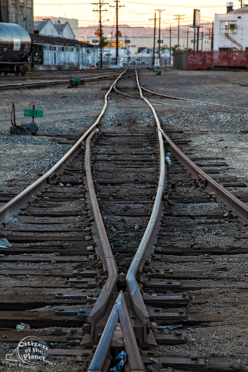Criss-crossing railroad tracks in Vernon, a very industrial city in the shadow of downtown Los Angeles, California, USA
