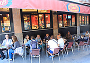 People drinking outside, Cerveceria 100 Montaditos chain bar pub, Madrid city centre, Spain